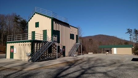 Green and tan burn building at the Fire Training Facility